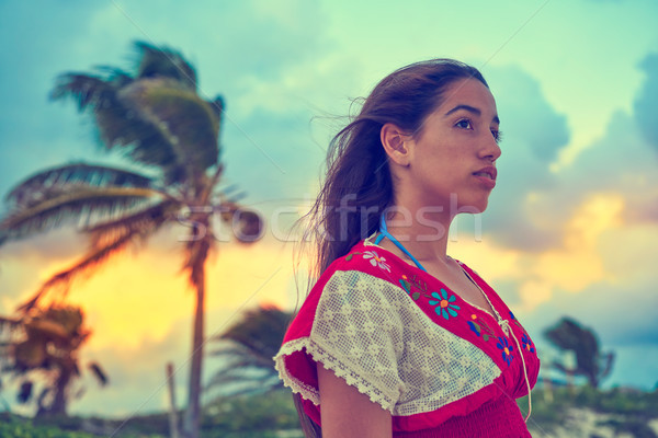 Mexican girl embrodery dress at sunset Stock photo © lunamarina
