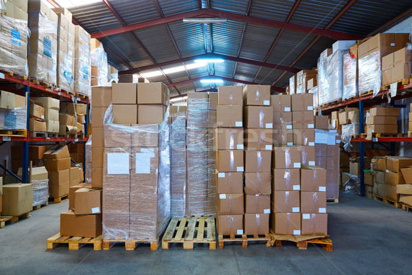 Warehouse stograge with stacked boxes in rows Stock photo © lunamarina