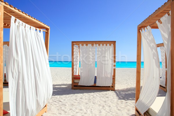 Caribbean gazebo beds in tropical beach sand Stock photo © lunamarina