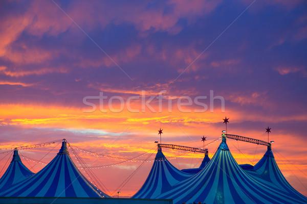 Circo tenda dramático pôr do sol céu colorido Foto stock © lunamarina