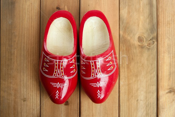 Dutch Holland red wooden shoes on wood Stock photo © lunamarina