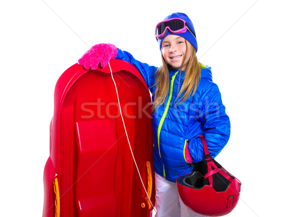 Blond kid girl with red sled snow equipment helmet and goggles Stock photo © lunamarina