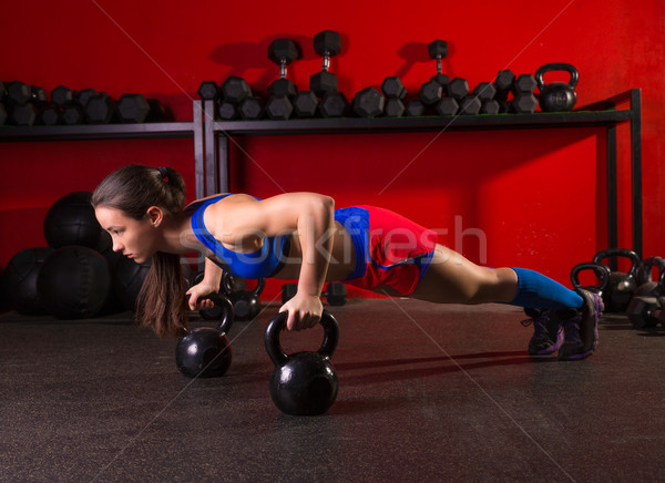Kettlebells push-up woman strength gym workout Stock photo © lunamarina
