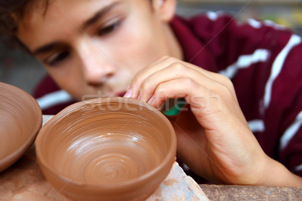 Stock photo: boy teen potter clay bowl working in pottery workshop