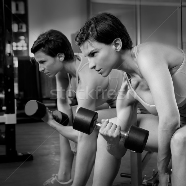 Crossfit fitness weight lifting Dumbbell woman at mirror Stock photo © lunamarina