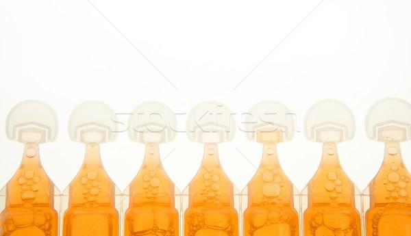 ampoule im plastic for liquid orange medicine Stock photo © lunamarina