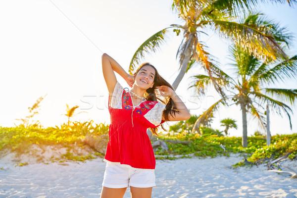 Happy latin beautiful girl in caribbean beach Stock photo © lunamarina