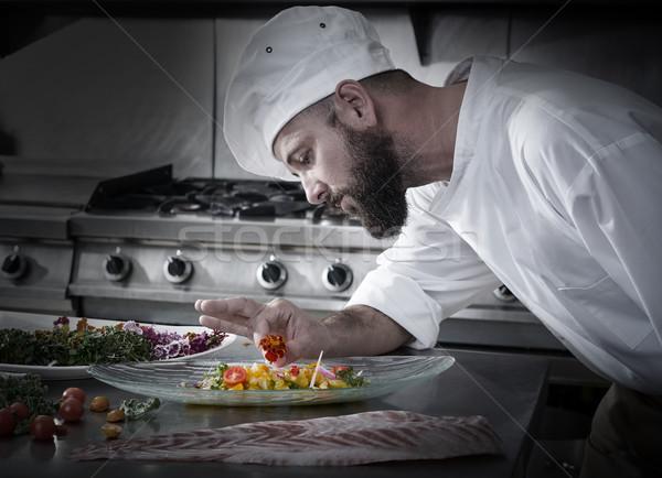 Chef garnishing flower in ceviche dish Stock photo © lunamarina