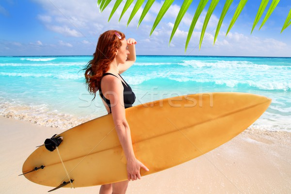 side view surfer woman tropical sea looking waves Stock photo © lunamarina
