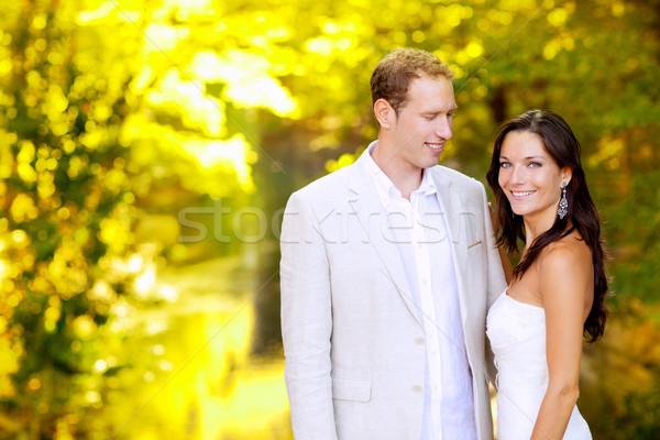 just married couple in honeymoon park Stock photo © lunamarina