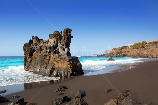 Stockfoto: Strand · zwarte · bruin · zand · water
