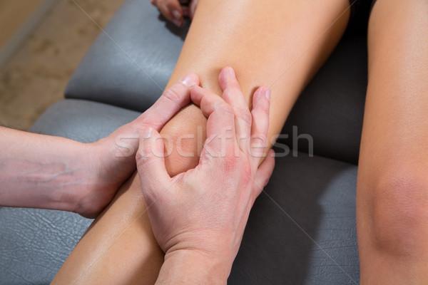 Maitland knee therapy massage on woman leg Stock photo © lunamarina