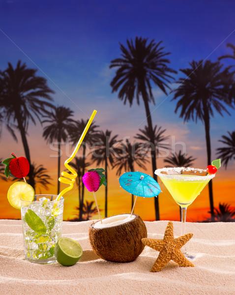 Photo stock: Plage · cocktail · coucher · du · soleil · palmier · sable · mojito