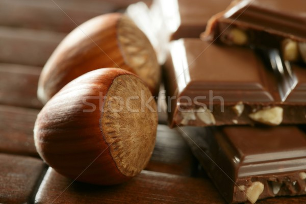 Hazelnuts and chocolate in brown enviroment Stock photo © lunamarina