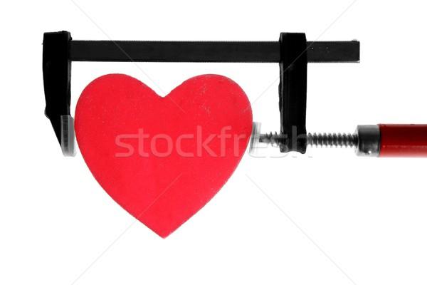 clamp grip tool pressing red heart Stock photo © lunamarina