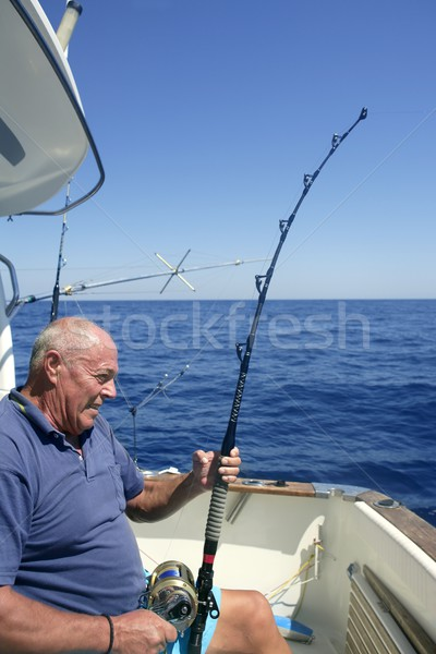 Angler elderly big game sport fishing boat blue summer sea sky Stock photo © lunamarina