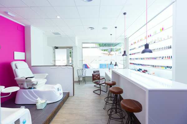 Nail saloon and pedicure chair spa modern with nail polish rows Stock photo © lunamarina