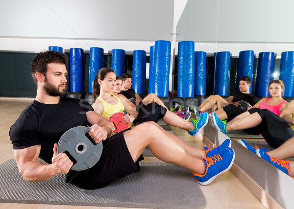 Abdominal plate training core group at gym Stock photo © lunamarina