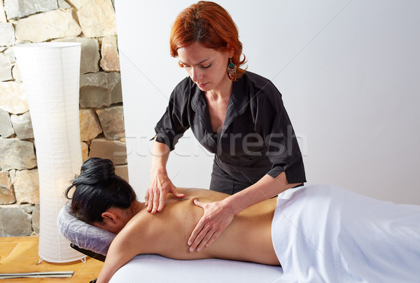 massage in woman back with physiotherapist Stock photo © lunamarina