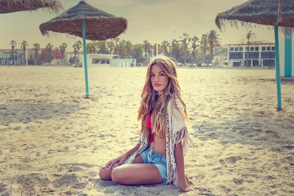 Blond teen girl sit on the beach sand Stock photo © lunamarina
