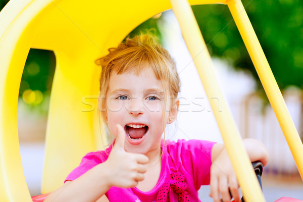 girl driving toy car with ok hand gesture Stock photo © lunamarina