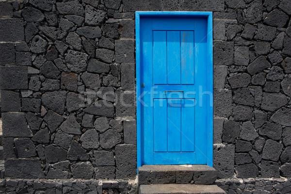 Blauw deur lava steen metselwerk muur Stockfoto © lunamarina