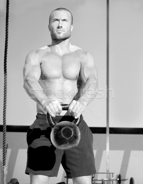 Stock photo: Crossfit Kettlebells swing exercise man workout
