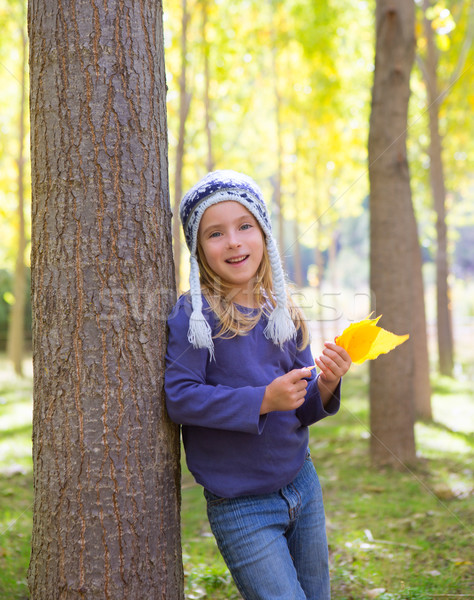 Child girl in autumn poplar forest yellow fall leaves in hand Stock photo © lunamarina