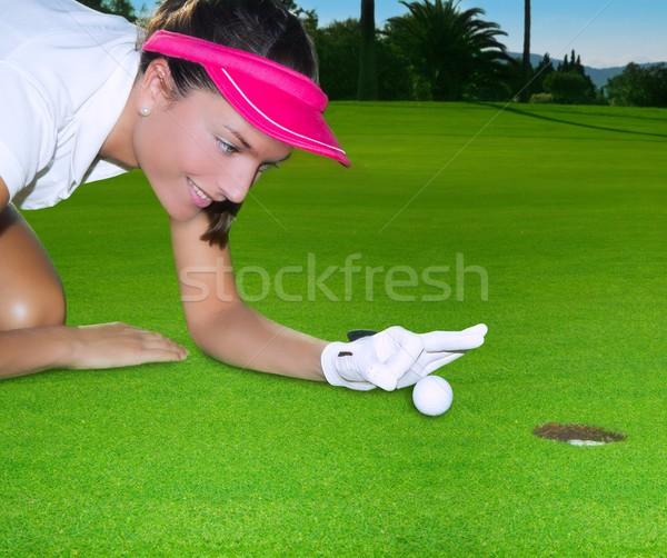 Golf green hole woman humor flicking hand a ball Stock photo © lunamarina