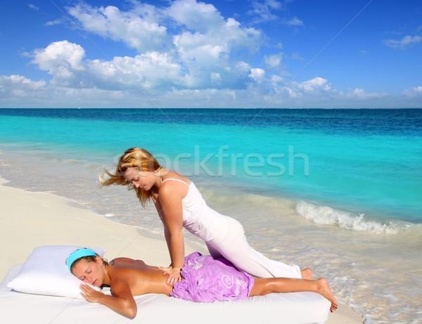 Caribbean beach massage shiatsu waist therapy Stock photo © lunamarina