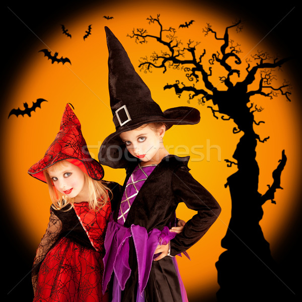 Halloween children girls with tree and bats Stock photo © lunamarina