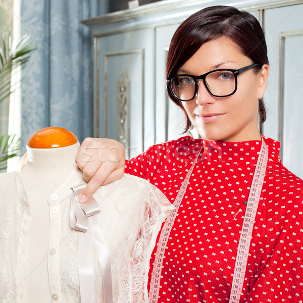 Stock photo: Dressmaker with mannequin working at home
