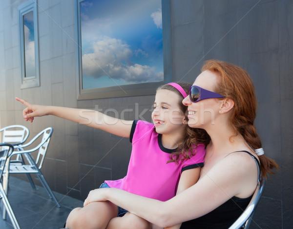 Children girl daughter sitting on mother lap Stock photo © lunamarina