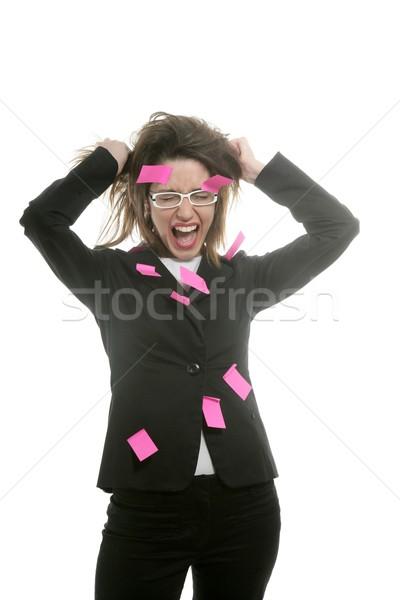 Businesswoman with multi task pink notes Stock photo © lunamarina