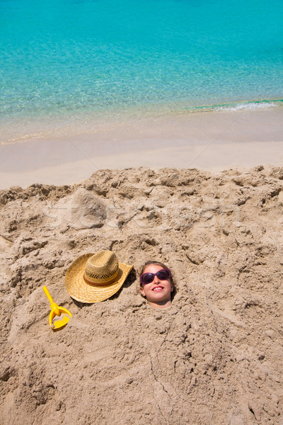 Funny girl playing buried in beach sand smiling sunglasses Stock photo © lunamarina