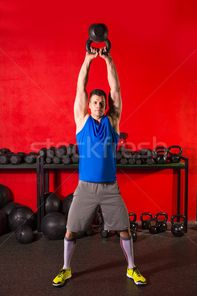 Stock photo: Kettlebell workout training man at gym