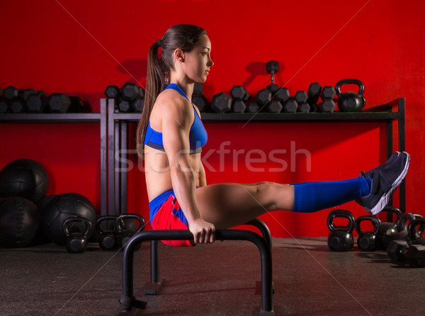 Parallettes woman parallel bars workout at gym Stock photo © lunamarina