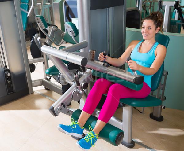Gym seated leg curl machine exercise woman Stock photo © lunamarina
