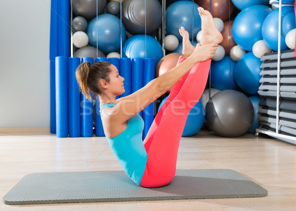 Pilates Open Leg Rocker exercise on mat woman Stock photo © lunamarina