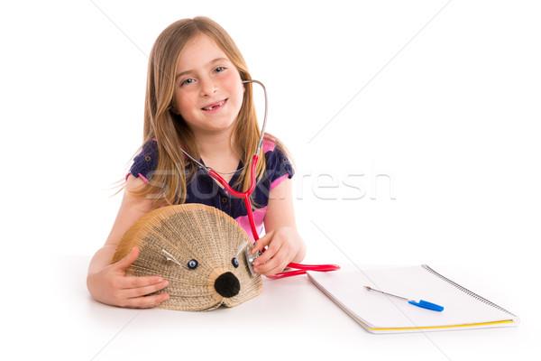 Blond kid girl pretending be doctor with hedgehog Stock photo © lunamarina