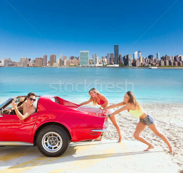 Car pushing teen girls humor funny guy driving Stock photo © lunamarina
