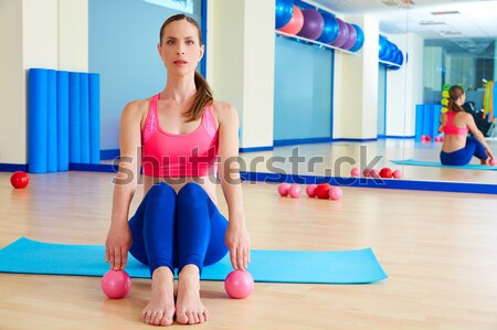 Pilates woman open leg rocker exercise workout Stock photo © lunamarina
