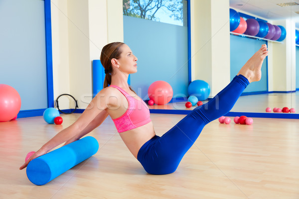 Pilates woman roller teaser roll exercise workout Stock photo © lunamarina