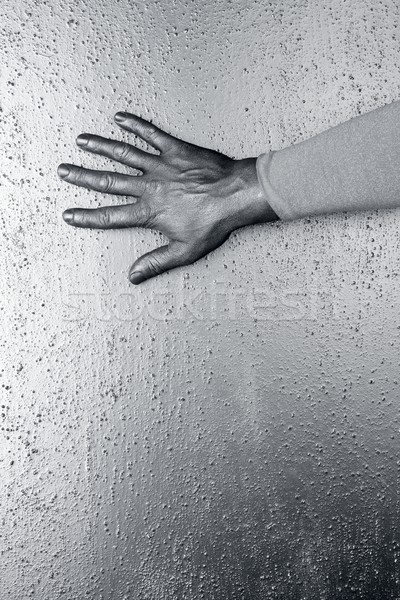 futuristic man silver hand over textured steel Stock photo © lunamarina