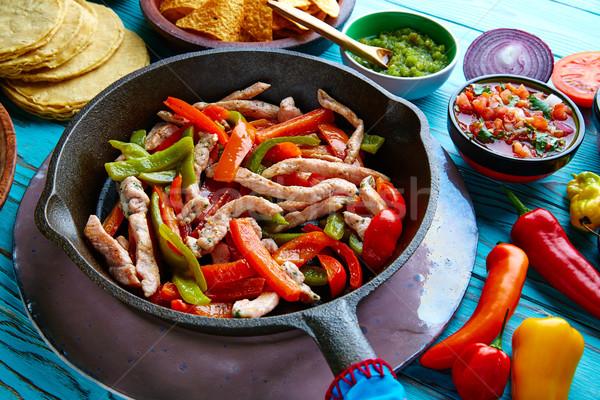 chicken fajitas in a pan chili and sides Mexican Stock photo © lunamarina