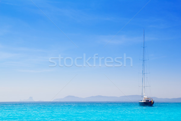 Ibiza mountains with sailboat from Formentera Stock photo © lunamarina