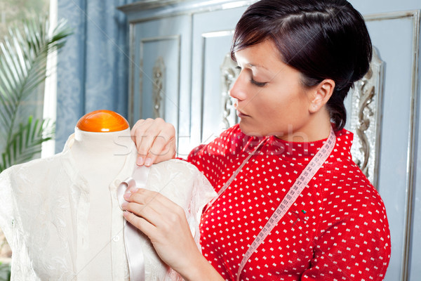 Dressmaker with mannequin working at home Stock photo © lunamarina