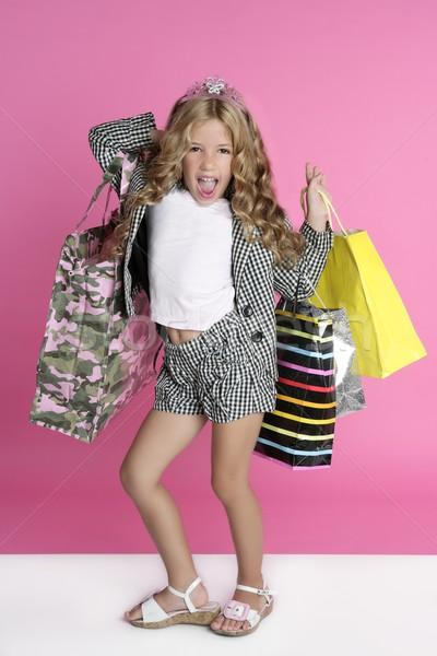 Little shopper humor shopaholic girl Stock photo © lunamarina