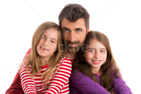 Happy family beard father and two daughters Stock photo © lunamarina