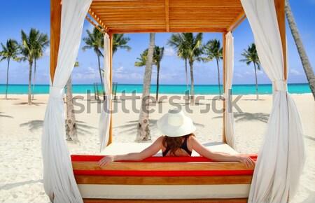 woman lying on pool bent palm tree trunk Stock photo © lunamarina